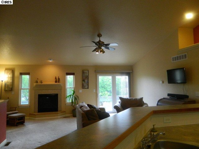 Living room with fireplace and valuted ceilings